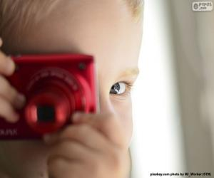 Rompicapo di Bambino con fotocamera fotografica