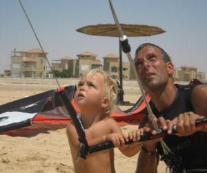 Rompicapo di Bambino facendo volare un aquilone con il padre