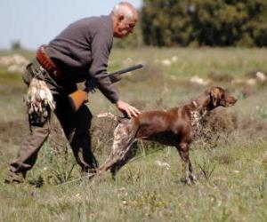 Rompicapo di Cacciatore di caccia con il suo cane