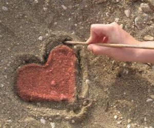 Rompicapo di Cuore disegnato nella sabbia