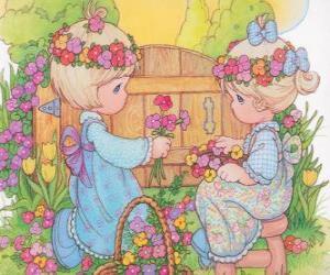 Rompicapo di Due ragazze raccolgono fiori. Precious Moments