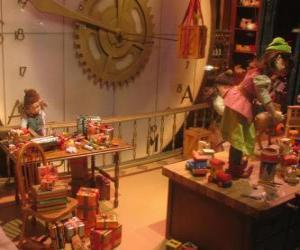 Rompicapo di Elfi di Natale nella creazione di giocattoli per i regali