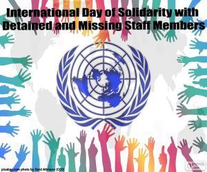 Rompicapo di Giornata internazionale di solidarietà con i membri del personale trattenuti o mancante