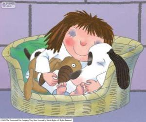 Rompicapo di La piccola principessa a letto con il suo cane Collottola e il suo orsacchiotto