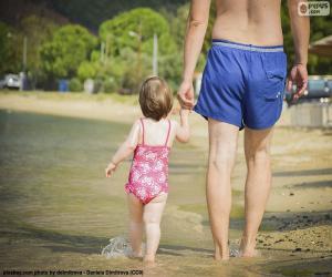 Rompicapo di Padre e figlia sulla spiaggia