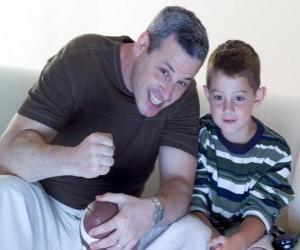 Rompicapo di Padri e figlio che assaporano una partita