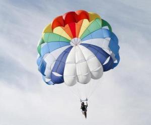 Rompicapo di Paracadutista giù attraverso le nubi di un paracadute dopo il salto da un aereo