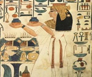 Rompicapo di Pietra con incisa egiziane di la rappresentazione di una dea con iscrizioni o geroglifici