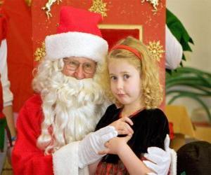 Rompicapo di Ragazza parlando congli Babbo Natale seduta sul tuo grembo