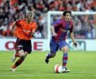 Giocatore di calcio (Bojan Krkic F.C.B) guida la palla