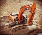 Grande escavatore cingolato