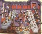 Scene di una cena medievale nel salone del palazzo o castello