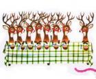 Gruppo di renne di Natale attesa per i prodotti alimentari