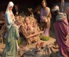 La Santa Famiglia nella stalla con il bue e il mulo, un pastore con una pecora e un re che i loro doni a Gesù