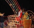 Babbo Natale che saluta con la mano dalla magica