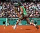 Partita di tennis con gli spettatori sulle tribune