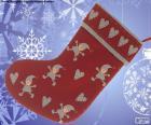 Calza di Natale decorato con elfi e cuori
