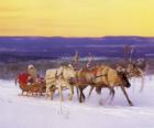 Natale in slitta trainata da renne e carichi di doni e di Babbo Natale