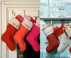 Diversi appendere calze di Natale pieno di doni