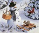 Pupazzo di neve con una uccelli scoiattolo e vari in giro