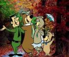 I protagonisti delle avventure: Orso Yoghi, Bubu, Cindy e il ranger del parco Smith