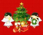 Due angeli con un albero di Natale