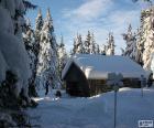 Cabina di legno una forte nevicata