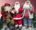 Tre bambole di Babbo Natale