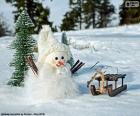 Pupazzo di neve e la slitta