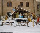 La rappresentazione della nascita di Gesù, la scena della Natività in una giornata nevosa