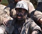 Un minatore sorridente