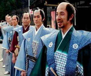 Rompicapo di Samurai con il vestito tradizionale, pantaloni larghi e kimono