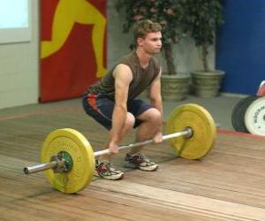 Rompicapo di Sollevamento pesi o pesistica - Atleta all'inizio del l'esercizio