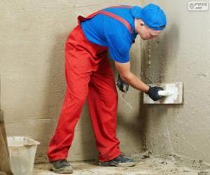 Rompicapo di Stuccatore lavorando su un rivestimento