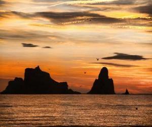 Rompicapo di Tramonto sul mare con le isole Medes in background