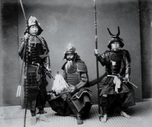 Rompicapo di Tre guerrieri samurai autentica, con l'armatura, il kabuto casco e armati