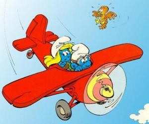 Rompicapo di Un Puffo e Puffetta pilotare un aereo rosso