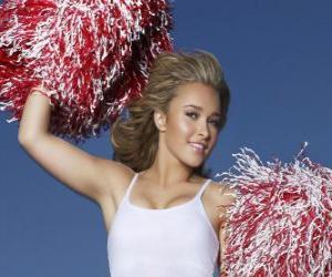 Rompicapo di Una cheerleader ou leader dei tifosi con pompon durante lo spettacolo